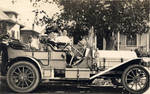 Chapman family members in a touring car, possibly in Covina, California, 1909