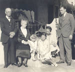 Chapman family group on porch, New Year's Day, 1929-1930