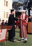 """President G. T. """"Buck"""" Smith presents Irvin C. """"Ernie"""" Chapman with 50th year diploma at Commencement, 1983"""