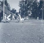 Don Rich makes a base hit during a baseball game at W. O. Hart Park, Orange, California, 1965