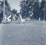 Chapman College baseball team in action at W.O. Hart Park in Orange, California, 1965