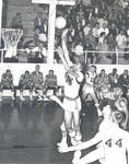 Jeff Cortwright and Woody Deitch on court during basketball game, Chapman College, Orange, California
