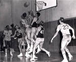 Frank Franklin [43], Tom Hart [23] and Hal Eidal [31], Chapman College basketball game