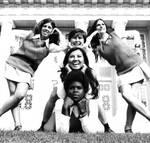 Cheerleaders posing on campus lawn, Chapman College, Orange, California, 1970