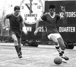Jorge Porras [right] eludes an opposing player
