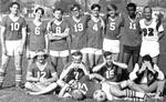 Chapman College soccer team poses for an informal group portrait, 1969