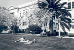 Students on lawn by Reeves Hall, Chapman College, Orange, California