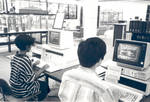 Using computers in the Thurmond Clarke Memorial Library, Chapman College, Orange, California