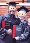 Two graduates with diplomas, 2002 Chapman University Commencement Ceremony