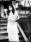 Peggy Reid holding a bouquet