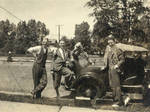Berndt and three friends, posing by an automobile
