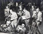 Photo journalists using 16mm cameras