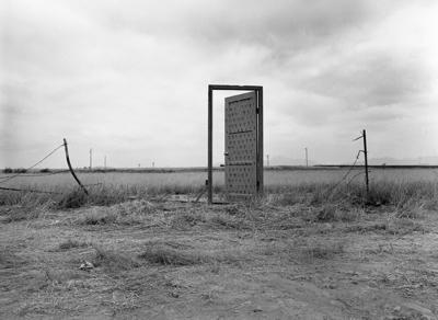 Richard Lou, Border Door, 1988, performance, Documentary photograph by Jim Elliot.