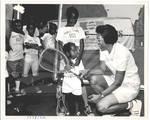 Children Participate in Mobile Tennis Program