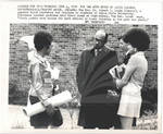 Professor in Discussion with Black Students